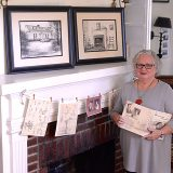 "Marianne Doyle displays ""Bonnie Knoll: The Tale of a Home That Grew,"" inside of her historic house. The book is a memoir written by a previous owner of the home. (Photo by Lisa Price)"