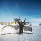 Bruce Tischbein of Zionsville pauses in front of the bulldozer he uses to clear snow in Antarctica. (Submitted photo)