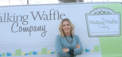 Stephanie Lewis in front of The Walking Waffle Company van. (Photo by Mark Ambrogi)