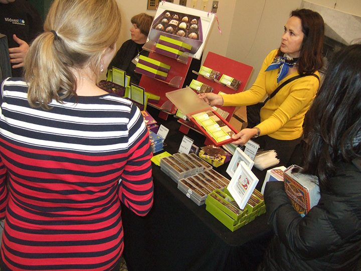 Joann Hofer of Xchocol'Art speaks with guests at the 2015 Green Gift Shop. (Submitted photo)