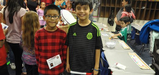 Leonel Cervantes and José Vargas present a booth about Mexico, offering tamales and displaying traditions.