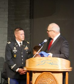 Army vet David Kinyon is presented with a Carmel Greyhounds shirt by CHS Principal John Williams. (Submitted photo)