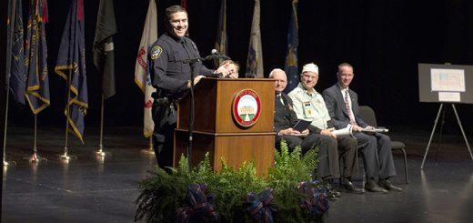 Air Force veteran Josh Govin of the Carmel Police Dept. speaks at the ceremony.