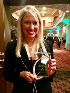 Ashley Ulbricht displays her award from Junior Achievement. (Submitted photo)