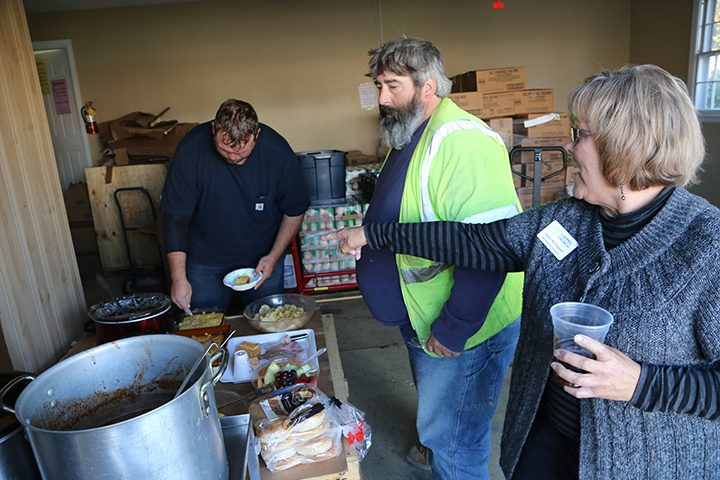 From right, Karen McTaggart, CUMC membership secretary, points out lunch options to Roy Bailes, Jr. and Jacob Farr. (Photo by Ann Marie Shambaugh)
