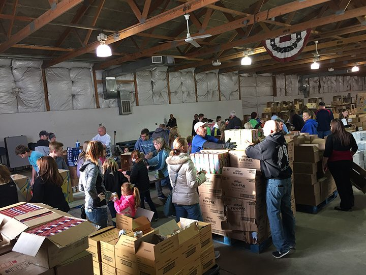 Members of Carmel Fraternal Order of Police Lodge 185 Foundation and their families help package food baskets. (Photo by Nick Poust)