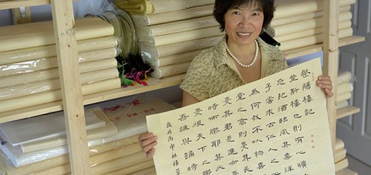 Jenny Feng displays her calligraphy in her Carmel home. (Photo by Lisa Price)