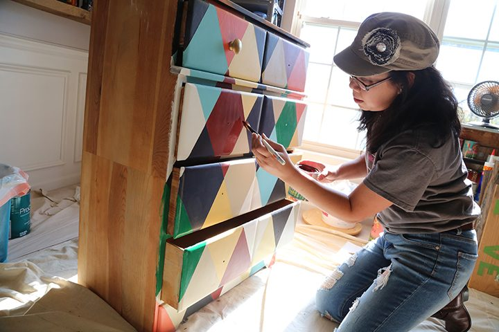 Meaghan Wolf, founder of Metamorphosis Design, paints furniture in her Carmel home. (Photo by Ann Marie Shambaugh)