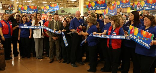 James Miles and Lavonda Slayton, center, cut the ribbon to the expanded Kroger at 116th Street and Olio Road. (Submitted photo)