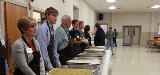 Volunteers at St. Louis de Montfort Catholic Church dish out food during last year's Thanksgiving dinner. (Submitted photo)