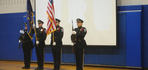 On Nov. 11, Fall Creek Junior High in Fishers held a school-wide Veterans Day Convocation. Members of the Fishers Police Dept. Color Guard perform at the event. (Photos by Anna Skinner)