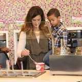 Carly Grant and her son Hudson serve themselves frozen yogurt during last year's Shop Fishers event. (Submitted photo)