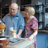 Tony Zancanaro pours coffee while his wife, Debbie, observes. (Photo by Anna Skinner)