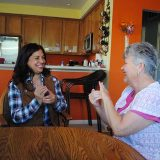 Colette Liose taps in her home with Reyna Williams. (Photo by Anna Skinner)
