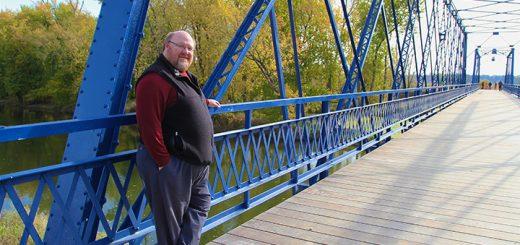 Hamilton County Parks and Recreation Director Al Patterson pauses on Washington County Bridge No. 113. (Photo by Sadie Hunter)