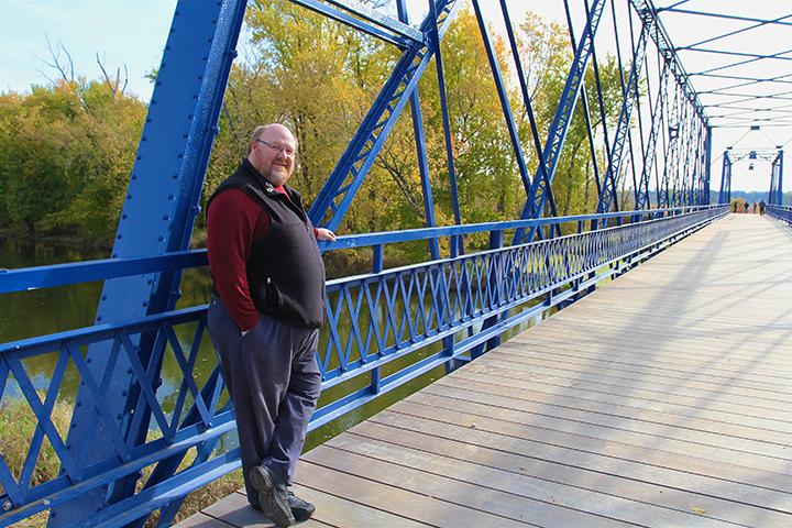 Al Patterson pauses on Washington County Bridge No. 113. (Photo by Sadie Hunter)
