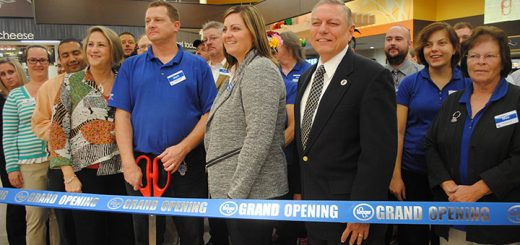 Thirty-year employee Mark Windsor cuts the ribbon in front of staff to open the new expanded Kroger at Carey Road and Ind. 32. (Photos by Anna Skinner)