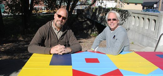 Jon Edwards, left, and Chris Blice at the Love is Primary picnic table. (Photo by Anna Skinner)