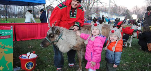 Lauren, middle, and Bradley Zelik pet Sven the reindeer at last year's Westfield in Lights. Two reindeer will be present this year. (File photo)