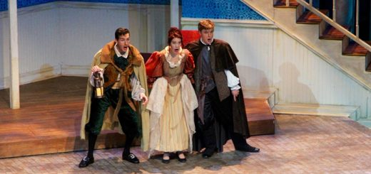 """""""The Barber of Seville"""" opera artists Michael Kelly, Deborah Domanski and Ben Robinson performing live on stage at the Tarkington Theatre."""