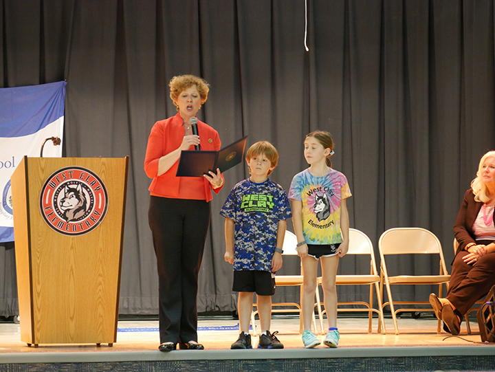 U.S. Rep. Susan Brooks reads the Congressional Record honoring West Clay's accomplishment as students Reese Blanchard and Jake Gardner look on. (Submitted photo)