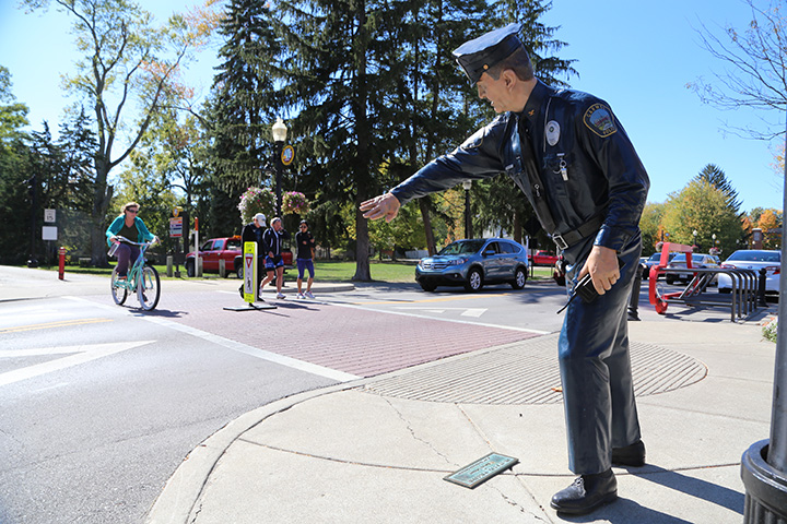 The police officer statue at Main Street and the Monon Greenway has been removed after being struck in a hit-and-run accident. (File photo)