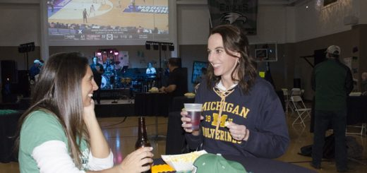 Kristin Kunttu and Jen Valentine, parents of Zionsville Middle School and Zionsville High School athletes, enjoy drinks and snacks at Eagle Madness. (Photo by Sara Baldwin)
