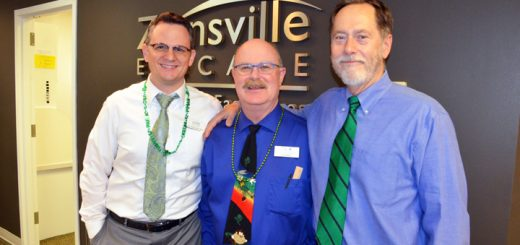 "Eastin (center) stands with Zionsville Eyecare co-owners Dr. Nicholas Garn (left) and Dr. James Haines (right). ""Lenny has been a good role model for the rest of the staff, and he will be missed,"" Haines said. (Photo by Sara Baldwin)"