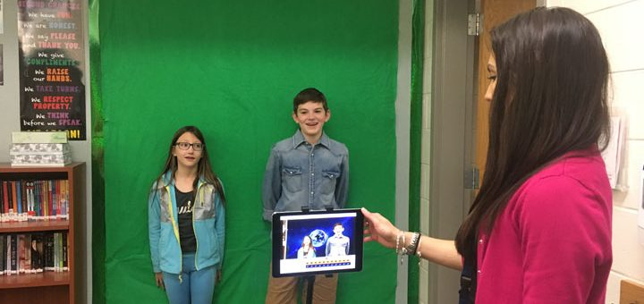 Towne Meadow Elementary teacher Josie McKay helps students Audrey Nace and Cal Bostic use a green screen for a class project. (Submitted photo)