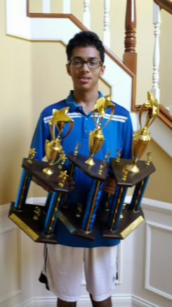 Ashwin Prasad displays his three Hamilton County Spelling Bee trophies. (Submitted photo)