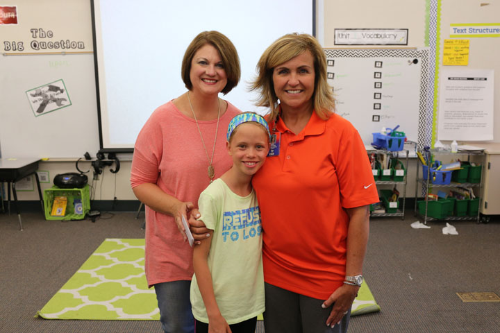 From left, Vicki Burdick of Edge Guys, Ellie Smith and Tracie Greene at the Teacher of the Month Party. (Photo by Ann Marie Shambaugh)