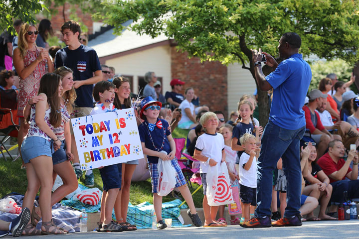 CBS 4 anchor Frank Mickens takes a photo during the parade. (Photo by Ann Marie Shambaugh)