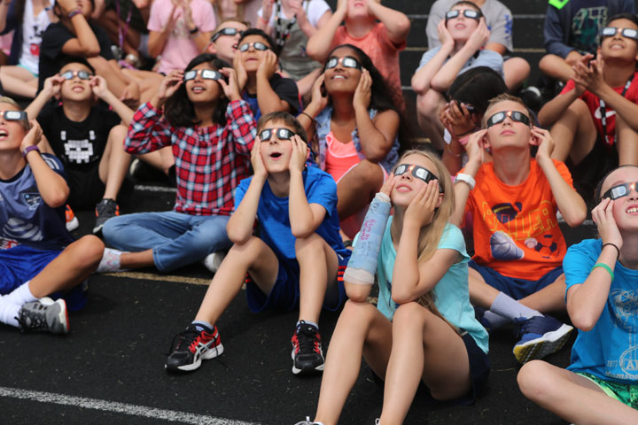 Students at Clay Middle School look at the eclipse. It was impossible to see at times because of cloud cover. (Photos by Ann Marie Shambaugh)