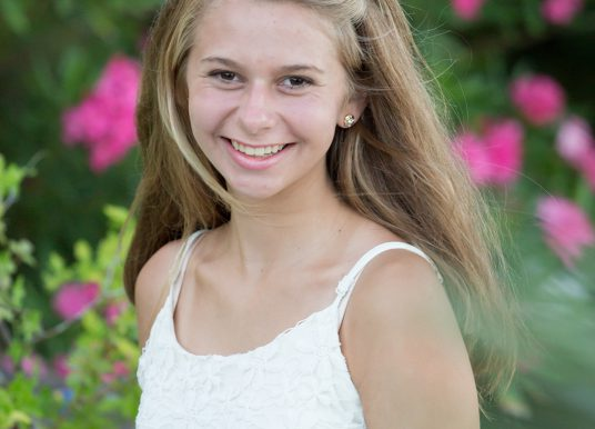 Fast-paced day: Carmel teen to sing national anthem at half marathon, compete in meet