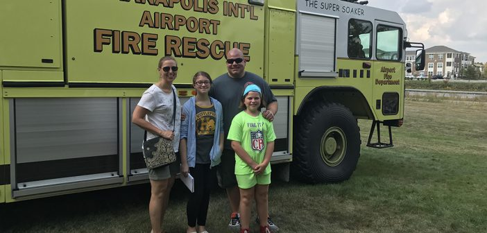 Fishers firefighter Tony Baskerville and his wife, Becky, and children, Olivia and Ava, at Carmel Public Safety Day. Departments from across the state brought vehicles and equipment for the family-friend public safety event.