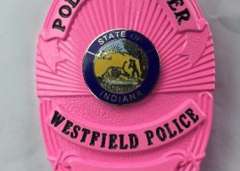 Police officers to wear pink badges in recognition of Breast Cancer Awareness Month