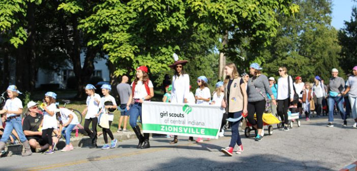 Girls scouts of central Indiana hand out candy in their pirate-themed attire.