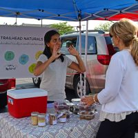 Akshaya That of Zionsville talks about her product to Teresa Peterson at the Pop Up Farmers' Market. (Photo by Dawn Pearson)