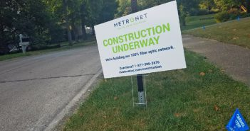 A MetroNet sign alerting Carmel residents to construction in the area remains standing after the city ordered the company to halt work after its subcontractors broke several gas lines. (Photo by Ann Marie Shambaugh)