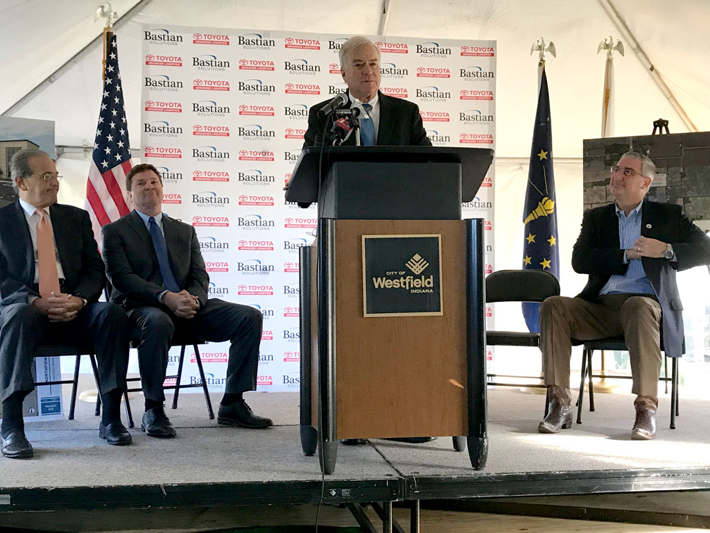 Mayor Andy Cook, center, speaks on Bastian Solutions announcement of a new manufacturing center to be built in Westfield. From left, Michael Romano, president of Toyota Advanced Logistics; Bill Bastian II of Bastian Solutions, Mayor Andy Cook and Gov. Eric Holcomb. (Photo by Anna Skinner)