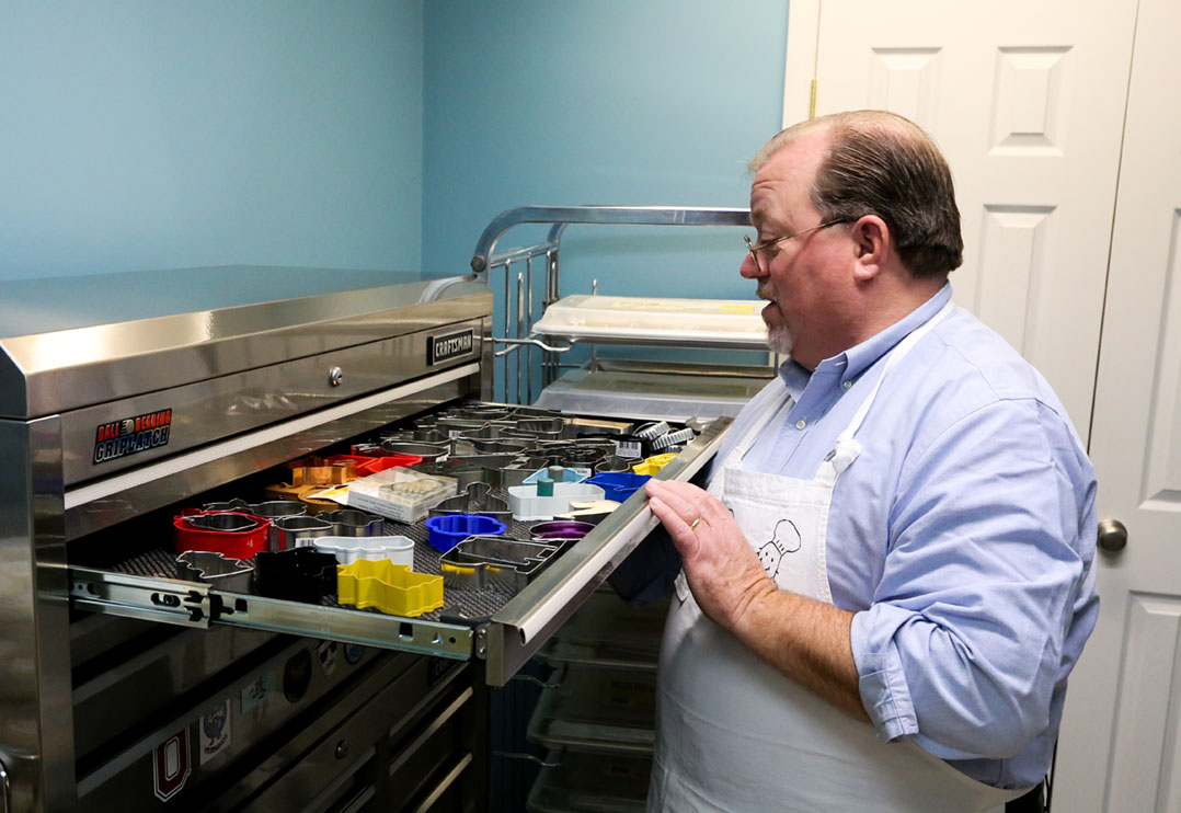 Dave Sanders looks through his collection of more than 1,000 cookie cutters. (Photo by Ann Marie Shambaugh)