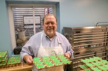 Dave Sanders displays custom sugar-cookies he baked and decorated in the commercial kitchen in his Carmel home. (Photo by Ann Marie Shambaugh)
