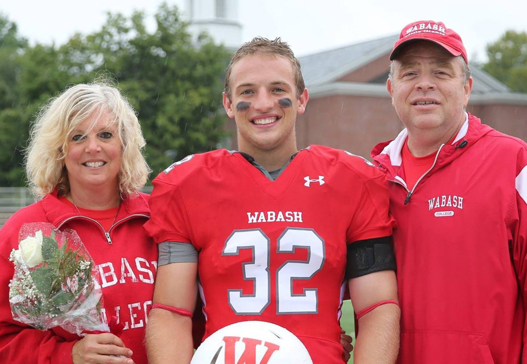 Evan Hansen, center, pauses with his mother, Mary, and father, Chuck, Sept. 8 at Wabash College's senior day, two days before he took his life. (Submitted photo)