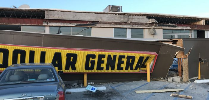 The façade of a building that housed Dollar General and an insurance firm at 8050 Pendleton Pike collapsed at approximately 4:15 p.m. Dec. 11. Three cars were damaged in the collapse. (Submitted photo)