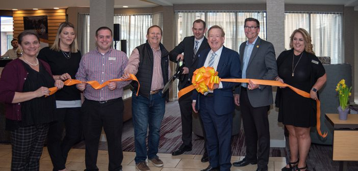 Courtyard by Marriott General Manager Patrick Durbin cuts the ribbon April 24 to celebrate renovations at the hotel at 37 W. 103rd St. Updates include new furniture, carpet and wall coverings throughout the hotel.