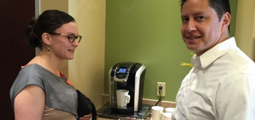 Amy Contreras, the interior designer for Expedite, and Abel Contreras, her guest wait for coffee at the open house.
