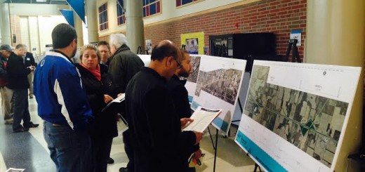 Attendees look at site maps for the roadways. (Photo by Adam Aasen)