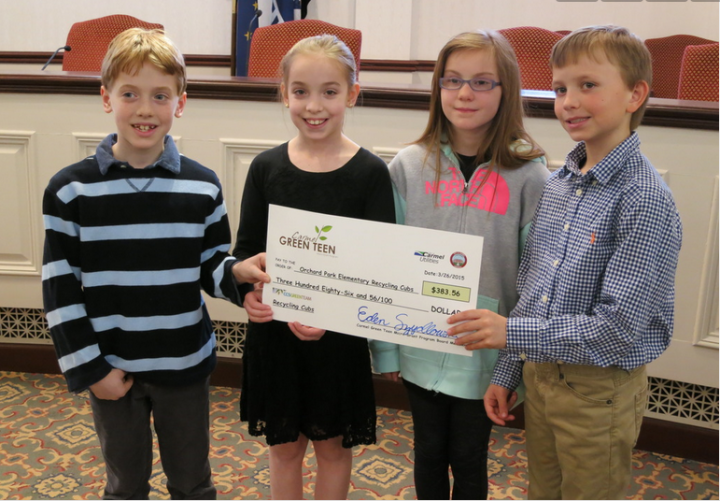 Orchard Park students proudly hold check. (Submitted photo)