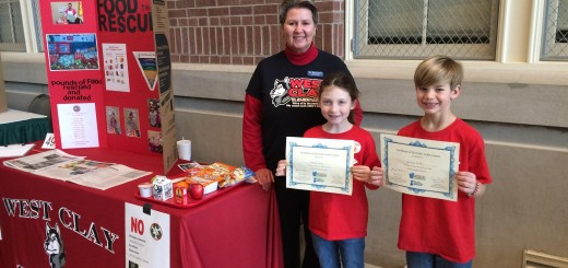 Lauren Clay and Briggs Griffin with cafeteria manager Beth Galloway took first place in K-4 division of the Eco Science Fair on March 20. Clay and Griffin won tickets to an Indianapolis Indians game and received certificates for their presentation to the judges.������������������