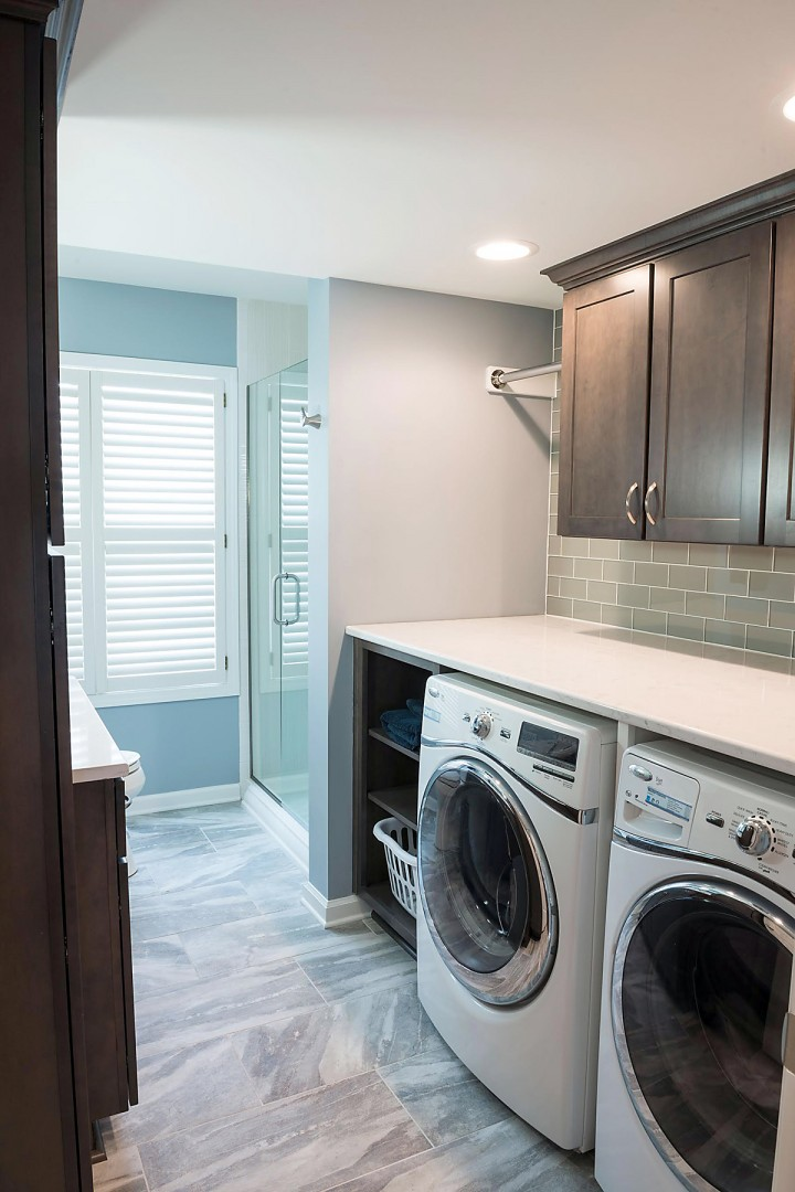 Column rearranging floor plan creates full bath laundry for Laundry plan